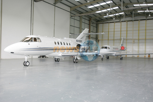 Private jets lined up in the hanger at weston airport, As the credit crunch and rising oil prices more and more of these private aircraft are being left hangered...Photo: Newsfile/Fran Caffrey.