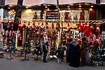 Palestinian vendors display flowers, red teddy bears, red ballons and pillows as part of Christmas and New Year festivities, in Gaza city, on December 31, 2019. Photo by Mahmoud Ajjour