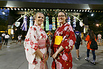 Visitors dressed in traditional Japanese clothing pose for a photograph during the annual ''Mitama Festival'' at Yasukuni Shrine on July, 13, 2017, Tokyo, Japan. Over 30,000 lanterns are displayed along the entrance of the shrine to help spirits find their way during the annual celebration for the spirits of ancestors. The festival runs until July 16th. (Photo by Rodrigo Reyes Marin/AFLO)