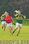 Bernie Breen (Kerry) gains control to set up another attack for Kerry, with Sinead OReilly (Cork) in hot pursuit during the rain swept Munster TG4 Senior Ladies Championship game in Beaufort last Saturday..