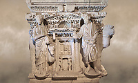 Roman sarcophagus with relief sculptures from Hierapolis . Hierapolis Archaeology Museum, Turkey<br /> <br /> Columned Sarcophagus Sarcopinagu of Euthios Pyrrnon, Asian Archon (ruler), Roman Period First quarter of third century A.D. Loadicea. <br />  <br /> Four sides of these sarcophagi are all in relief. They appear like a columned temple. The reliefs between the grooved columns are related to the private life of the individual. His/her education, heroic scenes and plant or mythological motifs are decorated in relief. The cover of the sarcophagus is arranged like a bed and it is depicted as the wife and the husband as lying on it. The name of the individual and some mythological reliefs are found in the surrounding of the cover. The two sarcophagi in the hall are of this kind. Against an art background