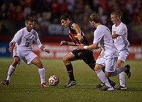Jake Pace (20) of Maryland tries to hold the ball away from Ryan Myers (10), Brandon Kolczynski (3), and Kevin Murray (14) of Pittsburgh during the game at Ludwig Field on the campus of the University of Maryland in College Park, MD.  Maryland defeated Pittsburgh, 2-0.