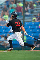Justin Yurchak (33) of the Great Falls Voyagers follows through on his swing against the Helena Brewers at Centene Stadium on August 18, 2017 in Helena, Montana.  The Voyagers defeated the Brewers 10-7.  (Brian Westerholt/Four Seam Images)