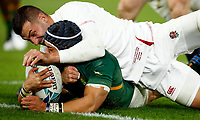 Jonny May of England tackling Cheslin Kolbe of South Africa during the Rugby World Cup Final match between South Africa Springboks and England Rugby World Cup Final at the International Stadium in Yokohama, Japan on Saturday, 2 November 2019. Photo: Steve Haag / stevehaagsports.com