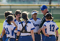NWA Democrat-Gazette/BEN GOFF @NWABENGOFF<br /> Mike Harper, Rogers head coach, huddles with the team Thursday, April 12, 2018, during the game against Springdale Har-Ber at Veterans Park in Rogers.