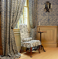 In the entrance hall of a London house an interesting layered effect has been acheived with the juxtaposition of two similar but different Arts & Crafts-style fabrics on the walls, curtains and loose covers