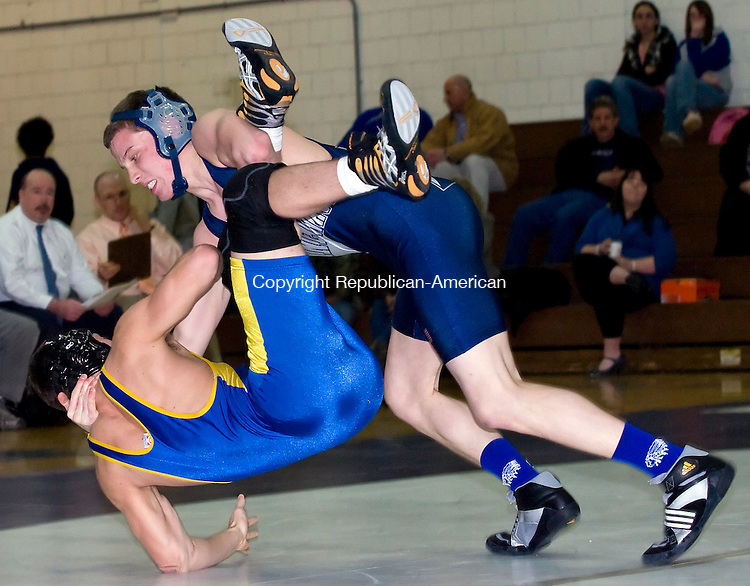 Woodbury, CT-27, January 2010-012710CM11  Nonnewaug's Dan Denslow (right) slams down Seymour's John Reilly during the 145 pound weight class match at Nonnewaug High School Wednesday night.  Denslow pinned Reilly in 1:35.    --Christopher Massa Republican-American