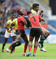 Sri Lanka's Shehan Pathirana is tackled by Papua New Guinea's Albert Levi, left, and Papua New Guinea's Stanis Susuve<br /> <br /> Papua New Guinea Vs Sri Lanka - Men's bowl quarter final<br /> <br /> Photographer Chris Vaughan/CameraSport<br /> <br /> 20th Commonwealth Games - Day 4 - Sunday 27th July 2014 - Rugby Sevens - Ibrox Stadium - Glasgow - UK<br /> <br /> © CameraSport - 43 Linden Ave. Countesthorpe. Leicester. England. LE8 5PG - Tel: +44 (0) 116 277 4147 - admin@camerasport.com - www.camerasport.com