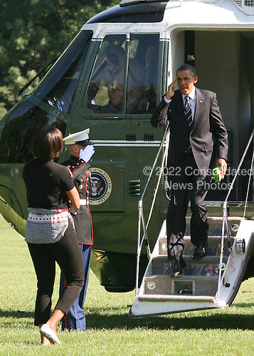 United States President Barack Obama salutes as he exits Marine 1 on the South Lawn of the White House in Washington, D.C. after on June 3, 2011. The President traveled to Toledo, Ohio to deliver remarks to autoworkers at Chrysler Toledo Supplier Park.  First Lady Michelle Obama joined the President to greet children who were waiting to see the arrival.  .Credit: Gary Fabiano / Pool via CNP