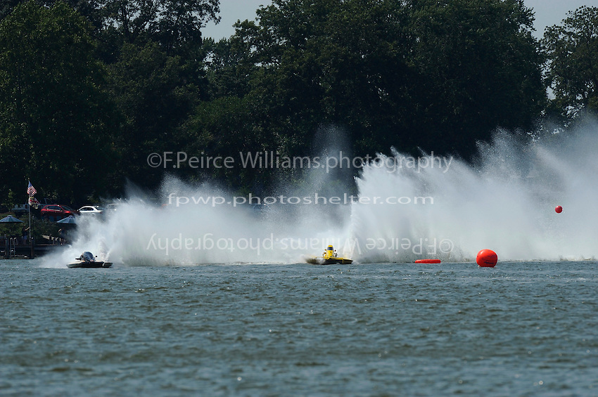 "Un-cropped version.End of third lap, final heat: Chuck Miller, Jr., NM-200 ""Mrjr's Lauterbach Special"" and Thom Heins, NM-30 ""Pennzoil Big Bird"" (National Mod hydroplane(s)"