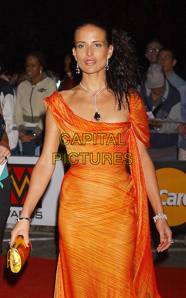 SOPHIE ANDERTON .Mastercard Mobo Awards 2003. Royal Albert Hall, South Kensington, London.25th September 2003 .half length, half-length, orange dress.www.capitalpictures.com.sales@capitalpictures.com.Supplied By Capital PIctures