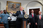 US President Donald J. Trump (C) delivers remarks beside workers (L), US Treasury Secretary Steven Mnuchin (2-R) and US Commerce Secretary Wilbur Ross (R), before signing a presidential proclamation on steel and aluminum tariffs, in the Roosevelt Room of the White House in Washington, DC, USA, 08 March 2018. President Trump is imposing tariffs on steel and aluminum imports. A decision to impose the tariffs on Canada or Mexico will not be decided until negotiations on the North American Free Trade Agreement (NAFTA).<br /> Credit: Michael Reynolds / Pool via CNP