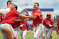 GCL Phillies East Jose Tortolero (right) celebrates with teammates after hitting a walk-off sacrifice fly during a Gulf Coast League game against the GCL Yankees East on July 31, 2019 at Yankees Minor League Complex in Tampa, Florida.  GCL Phillies East defeated the GCL Yankees East 4-3 in the second game of a doubleheader.  (Mike Janes/Four Seam Images)