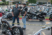NWA Democrat-Gazette/ANTHONY REYES &bull; @NWATONYR<br /> Billy Phelps, of Springdale, left, talks with Darryl Gibbs of Springdale, from left, Tuesday, Sept. 22, 2015 about Gibbs custom motorcycle during the unofficial kickoff for the Bikes, Blues and BBQ rally at Jose&rsquo;s Southwest Grill in Springdale. Gibbs motocycle is a 2006 custom motorcycle by Joe Martin in Duncan, Texas. The event featured hundreds of motorcyclists, live music, a &quot;Bike of the Year&quot; contest and a motorcycle give away.