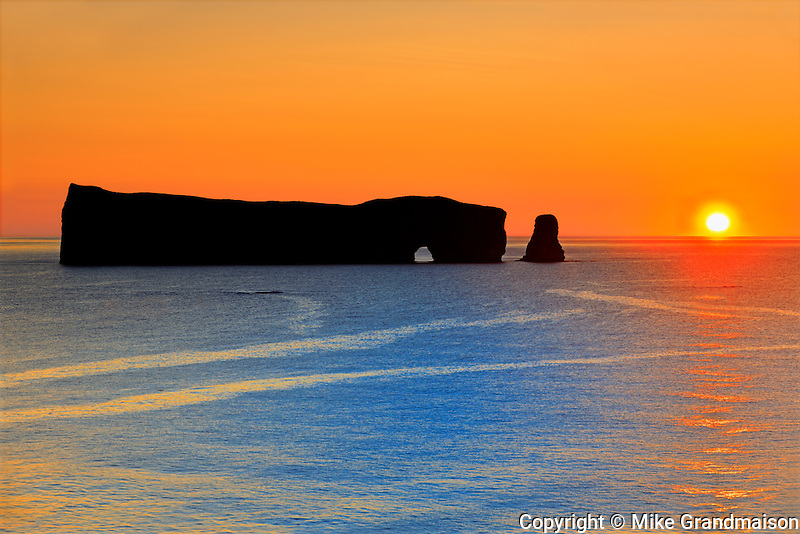 Roche Perce and Atlantic Ocean st sunrise on Gaspe Peninsula <br /> Perce<br /> Quebec<br /> Canada
