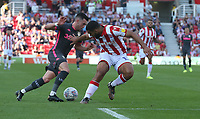 Leeds United's Jack Harrison battles with  Stoke City's Cameron Carter-Vickers<br /> <br /> Photographer Stephen White/CameraSport<br /> <br /> The Premier League - Stoke City v Leeds United - Saturday August 24th 2019 - bet365 Stadium - Stoke-on-Trent<br /> <br /> World Copyright © 2019 CameraSport. All rights reserved. 43 Linden Ave. Countesthorpe. Leicester. England. LE8 5PG - Tel: +44 (0) 116 277 4147 - admin@camerasport.com - www.camerasport.com