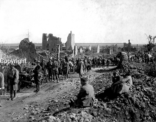 Eighteenth Infrantry, Machine Gun Battalion passing through St. Baussant in advance upon St. Mihiel Front.  September 13, 1918.  Attributed to Sgt. J. A. Marshall. (Army)<br /> NARA FILE #:  111-SC-20936<br /> WAR & CONFLICT BOOK #:  644