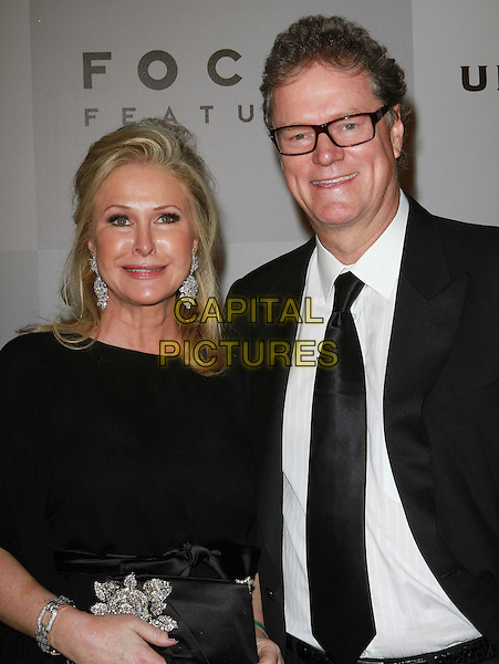 KATHY HILTON & RICK HILTON.NBC Universal 68th Annual Golden Globe Awards After Party held at the Beverly Hilton, Beverly Hills, California, USA..January 16th, 2011.half length black dress clutch bag suit jacket tie white shirt glasses married husband wife .CAP/ADM/KB.©Kevan Brooks/AdMedia/Capital Pictures.