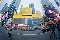A billboard in Times Square in New York advertises the disappearing photo app, Snapchat, seen on Monday, June 1, 2015.  (© Richard B. Levine)