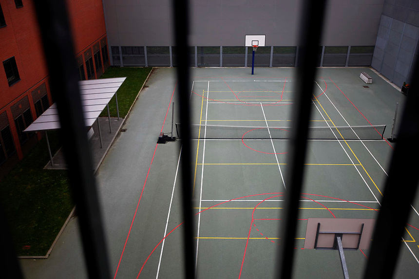 Tennis and basketball courts are seen thought the bars of one of the cells at the Detention Unit of the International Criminal Tribunal for the former Yugoslavia (ICTY) in Hague September 20, 2011. While awaiting or undergoing trial, around 40 people from the former Yugoslavia of different ethnic and religions accused of war crimes spend their time in peace and harmony at the detention unit of ICTY located within a Dutch prison complex in the Scheveningen neighborhood of Hague.  REUTERS/Damir Sagolj (NETHERLANDS)