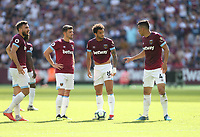 West Ham United's Robert Snodgrass, Aaron Cresswell, Felipe Anderson and Fabian Balbuena discuss a free-kick<br /> <br /> Photographer Rob Newell/CameraSport<br /> <br /> The Premier League - West Ham United v Wolverhampton Wanderers - Saturday 1st September 2018 - London Stadium - London<br /> <br /> World Copyright © 2019 CameraSport. All rights reserved. 43 Linden Ave. Countesthorpe. Leicester. England. LE8 5PG - Tel: +44 (0) 116 277 4147 - admin@camerasport.com - www.camerasport.com