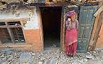 A woman talks on her mobile phone in Dhawa, a village in the Gorkha District of Nepal, which was hard hit by the 2015 earthquake.