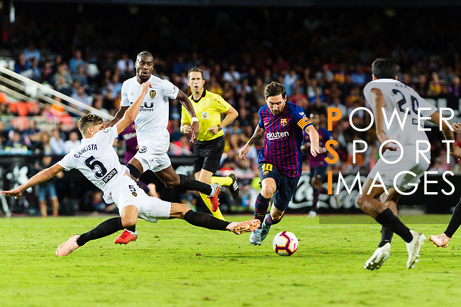 Gabriel Armando de Abreu of Valencia CF (L) trips up with Lionel Messi of FC Barcelona (R) during their La Liga 2018-19 match between Valencia CF and FC Barcelona at Estadio de Mestalla on October 07 2018 in Valencia, Spain. Photo by Maria Jose Segovia Carmona / Power Sport Images