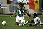 1 March 2006: Mexico's Mario Perez (15) goes down from the challenge of Ghana's Otto Addo (right), who plays the ball away. The National Team of Mexico defeated the National Team of Ghana 1-0 at Pizza Hut Park in Frisco, Texas in an International Friendly soccer match.