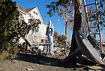Post Superstorm Sandy cleanup Union Beach, New Jersey.  A statue still stands amongst the rubble on Front Street.  Photo By Bill Denver