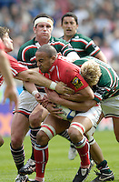 Leicester, Great Britain, Scarlets' Gavin THOMAS, tackled by Lewis MOODY, during the Heineken Cup Semi Final, Leicester Tigers vs Llanelli Scarlets played at the Walker Stadium, on Sat. 21.04.2007.