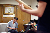 Sondre Lerche writes the set list while members from the band Midlake rehearse in the green room of Central Presbytarian Church in Austin, Texas during the 2011 SXSW Music Festival.