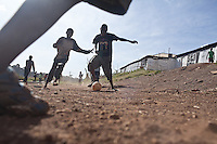 """""""Charities are businesses; They have to show kids playing in shit to get money. Do you see any kids playing in shit here?"""" asked Octopizzo as we passed a fgroup of kids playing soccer."""