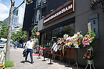 A man walks pass the new Honey Baked Ham store in Tokyo, Japan on August 6, 2015. The Honey Baked Ham Company LLC in collaboration with Toranomon Ham Co., Ltd., opened its first international store in downtown Tokyo. The company with more than 400 locations in the USA is expanding its operations overseas for first time in its 55-year history. (Photo by Rodrigo Reyes Marin/AFLO)