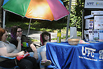 Volunteers at the Ulster Prevention Council's Family Services Booth, one of the many community service groups provided information at various booths at the 11th Annual Mid-town Make a Difference Day Celebration on Franklin Street, in Kingston, NY on Saturday, June  18, 2016. Photo by Jim Peppler. Copyright Jim Peppler 2016.