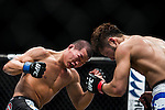 Kazuki Tokudome of Japan and Yui Chul Nam of South Korea fight on their Lightweight Bout 3 Rounds during the UFC Fight Night at the Cotai Arena on 01 March 2014 in Macau, China. Photo by Victor Fraile / Power Sport Images