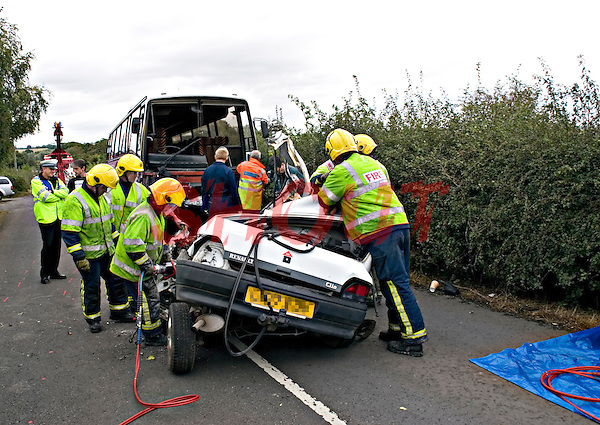 Firefighters using their dedicated cutter on the remains of a Renault Clio car. This image may only be used to portray the subject in a positive manner..©shoutpictures.com..john@shoutpictures.com