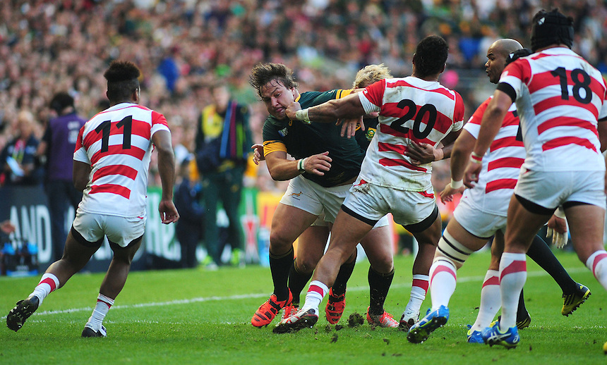 Japan's Amanaki Mafi gets to grips with South Africa's Coenie Oosthuizen<br /> <br /> Photographer Kevin Barnes/CameraSport<br /> <br /> Rugby Union - 2015 Rugby World Cup - Japan v South Africa - Saturday 19th September 2015 - The American Express Community Stadium - Falmer - Brighton<br /> <br /> &copy; CameraSport - 43 Linden Ave. Countesthorpe. Leicester. England. LE8 5PG - Tel: +44 (0) 116 277 4147 - admin@camerasport.com - www.camerasport.com