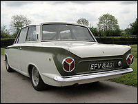 BNPS.co.uk (01202 558833)<br /> Pic: H&amp;H/BNPS<br /> <br /> A classic 1965 Ford Lotus Cortina has emerged for auction and is tipped to sell for &pound;55,000.<br /> <br /> This sports saloon car was one of the last Mark 1 models to be made before they introduced the Mark 2 in 1966.<br /> <br /> Cortinas were hugely successful racing cars in the 1960s with motorsport legend Jim Clark securing many wins in the stylish vehicle. <br /> <br /> The powerful 105bhp car with a 1558cc engine was restored at a cost of &pound;15,000 in 2002 and competed in circuit races and hill climbs but more recently has been in storage.