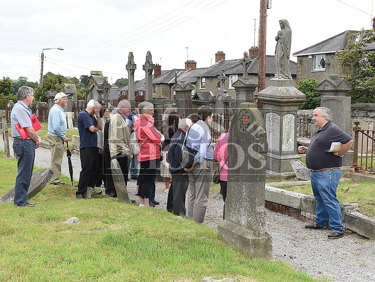 Sean Collins gives a tour of the Cord Cemetery as part of National Heritage Week. Photo:Colin Bell/pressphotos.ie