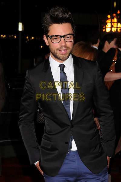Dominic Cooper.The World Premiere of 'Immortals' held at The Nokia Theater Live in Los Angeles, California, USA..November 7th, 2011.half length shirt jacket black white tie glasses beard facial hair.CAP/ADM/BP.©Byron Purvis/AdMedia/Capital Pictures.