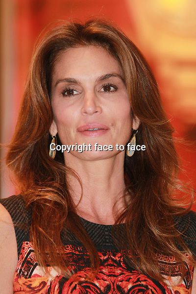MIAMI, FL - DECEMBER 4: Cindy Crawford at the grand opening of OMEGA Boutique at Aventura Mall in Miami, Florida on December 4, 2013. <br /> Credit: MediaPunch/face to face<br /> - Germany, Austria, Switzerland, Eastern Europe, Australia, UK, USA, Taiwan, Singapore, China, Malaysia, Thailand, Sweden, Estonia, Latvia and Lithuania rights only -