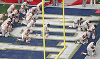 The Buckeyes kneel down to pray before the start of the Fiesta Bowl against Notre Dame at University of Phoenix Stadium in Glendale, AZ on January 1, 2016.  (Chris Russell/Dispatch Photo)