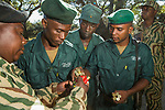 Anti-poaching scouts receiving bullets before deployment, Kafue National Park, Zambia