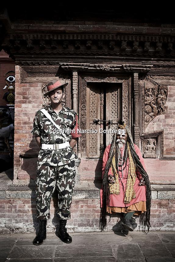 SOLDIER & SADDHU IN DURBAR SQUARE KATHMANDU, NEPAL