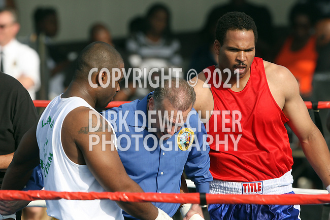 """Whittier, CA 05/10/08 - Ryan Watson of the Los Angeles County Fire Department (in red shirt and black trunks) boxes against Los Angeles County Sheriff's Department's Rashaan """"The Sleeper"""" Harrison during the LASD boxing event held at the Los Angeles County Sheriff's Academy in Whittier."""