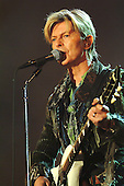 DAVID BOWIE (8 Jan 1947 - 10 Jan 2016) - performing live on his last live performance in the UK as the headline act on Day 3 at the 2004 Isle of Wight Festival held in Newport, IoW, UK - 13 June 2004. Photo by: George Chin/IconicPix