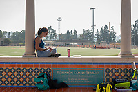 Audrey Shawley '18 works on some Athletics work on the newly built Robinson Family Terrace at the McKinnon Family Tennis Center, Nov. 6, 2019.<br />