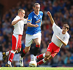 David Weir powers his way through the Falkirk midfield to set up an attack for Rangers