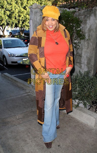 "KYM WHITLEY.""The 2009 Valentine / Oscar Celebrity Romance Suite""  held at Cafe La Boheme, West Hollywood, California, USA..February 10th, 2009.full length jeans denim orange red top yellow hat brown patch coat .CAP/ADM/KB.©Kevan Brooks/AdMedia/Capital Pictures."