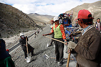 "China started building a controversial 67-mile ""paved highway fenced with undulating guardrails"" to Mount Qomolangma, known in the west as Mount Everest, to help facilitate next year's Olympic Games torch relay. Tibet, China.<br /> July, 2007"